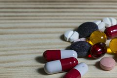 Tablets and pills different colors. The pills in the vial stock photos