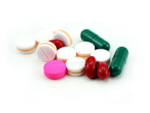 Tablets pills heap color mix therapy doctor flu antibiotic medic Stock Images
