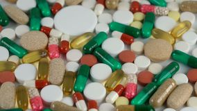 Tablets and pills rotate on a turntable. Seamless loopable stock footage