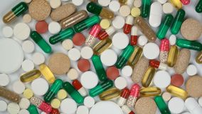 Tablets and pills rotate on a turntable. Seamless loopable stock video