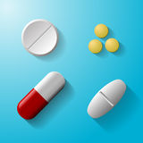 Tablets and pills vector set  on blue background. Royalty Free Stock Images