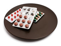 Tablets on a plate Royalty Free Stock Photo