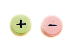 Plus or minus choice. Tablets with plus and minus sign isolated on white. Choice concept Stock Photo