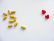 Tablets and red hearts isolated with place for writing. Tablets and red hearts on white background with place for writing Stock Photography
