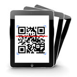 Tablets scanning a code Royalty Free Stock Images