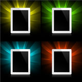 Tablets on shining background Stock Photos