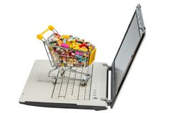 Tablets with shopping cart and computer Royalty Free Stock Photos
