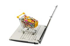 Tablets with shopping cart and computer Stock Photography