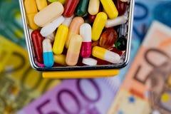 Tablets, shopping cart, euro bills Royalty Free Stock Photography