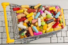 Tablets with shopping cart Royalty Free Stock Photo
