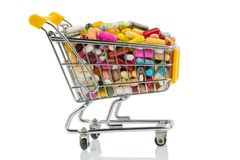 Tablets with shopping cart. Photo icon for the purchase of drugs on the internet Stock Photos