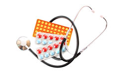 Tablets and stethoscope Stock Images