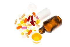 Tablets and syrups forms of medication royalty free stock images
