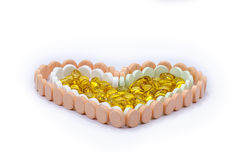 Tablets und Kapseln in der Herzform. Stockfotos