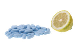 Tablets Vitamins and lemon fruit comparison is better for your health. Stock Photo