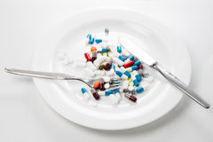Tablets on a white plate Royalty Free Stock Images