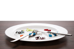 Tablets on a white plate Stock Image