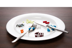 Tablets on a white plate Stock Photos