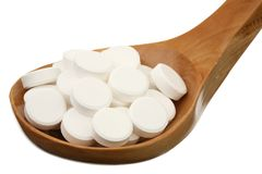 Tablets in a wooden spoon Royalty Free Stock Photography