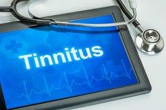 Tablette avec l'acouphène de diagnostic Photo libre de droits