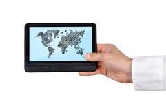 Tablette avec la carte du monde Photos stock