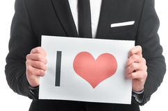 Tablette avec le coeur peint dans des mains de l'homme Photo libre de droits