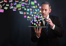 Tablette avec le nuage des icônes d'application Image stock