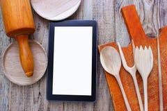 Tablette avec un écran blanc, pour le texte, parmi Photos libres de droits