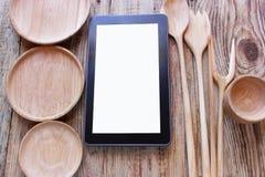 Tablette avec un écran blanc, pour le texte, parmi Images libres de droits