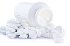 Tablette branco e frasco isolados Foto de Stock