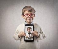 Tablette d'enfant photographie stock libre de droits