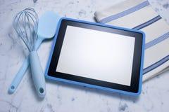 Tablette d'ordinateur faisant cuire le fond Photos stock