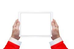 Tablette dans la main de Santa Claus Affichage et fond d'isolement par blanc Photos stock