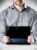 Tablette de Showing Powered Off d'homme d'affaires photo libre de droits