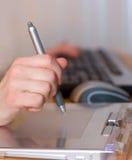 Tablette de travail de bras Photographie stock