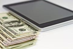 Tablette et argent Images libres de droits