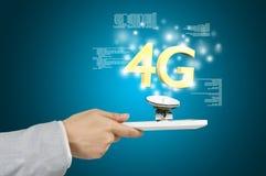 Tablette 4G de prise de main Images stock