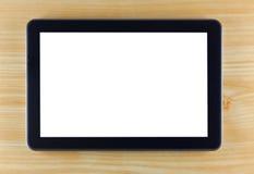 Tablette noire sur le fond en bois Photos libres de droits