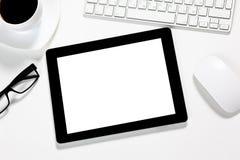 Tablette sur la table Images stock