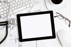 Tablette sur la table au docteur Images libres de droits