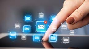 Tablette tactile de doigts avec le courrier Photo libre de droits