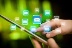 Tablette tactile de doigts avec le courrier Photographie stock libre de droits