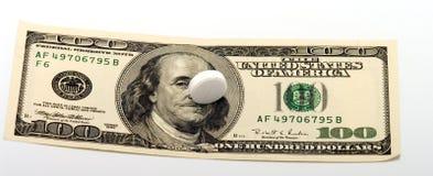 Tablette und Dollar. Stockbild