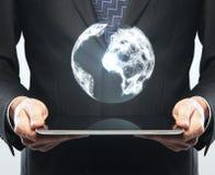 Tablette und Erde Lizenzfreies Stockfoto