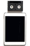 Tablette vide avec Mini Video Tape sur supérieur d'isolement sur le blanc images stock