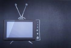 Tablettecomputer als Fernsehapparat Lizenzfreie Stockfotos