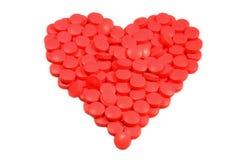Tabletten in een hartvorm stock fotografie