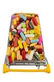 Tabletten met boodschappenwagentje Stock Afbeelding