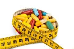 Tabletten und messendes Band Lizenzfreie Stockbilder
