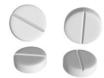 Tablettes blanches dans différentes positions sur le dos de blanc Photographie stock